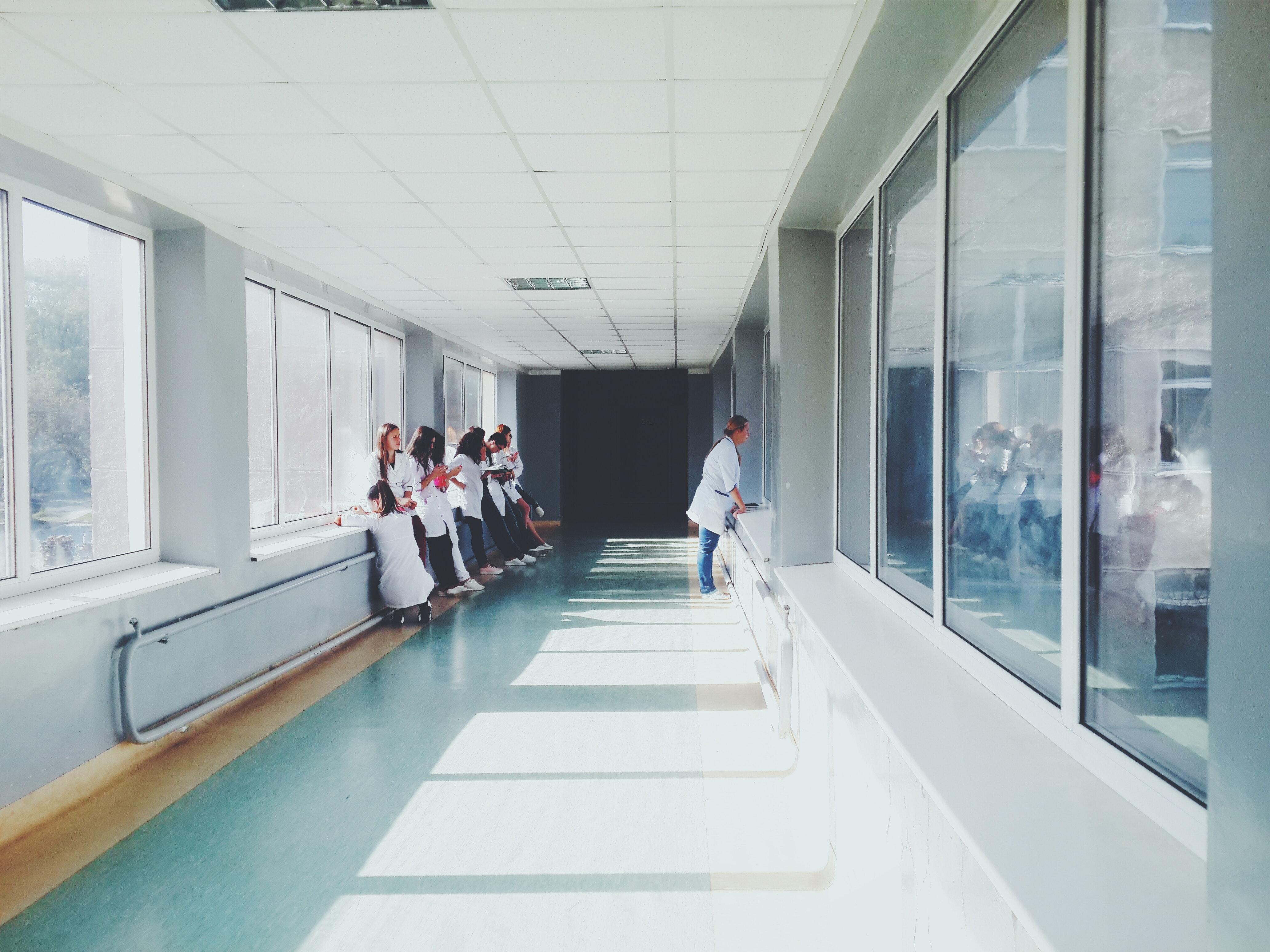 women in a hospital hallway