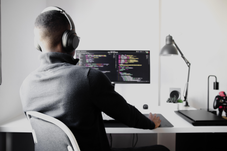 developer coding computer headphones technology