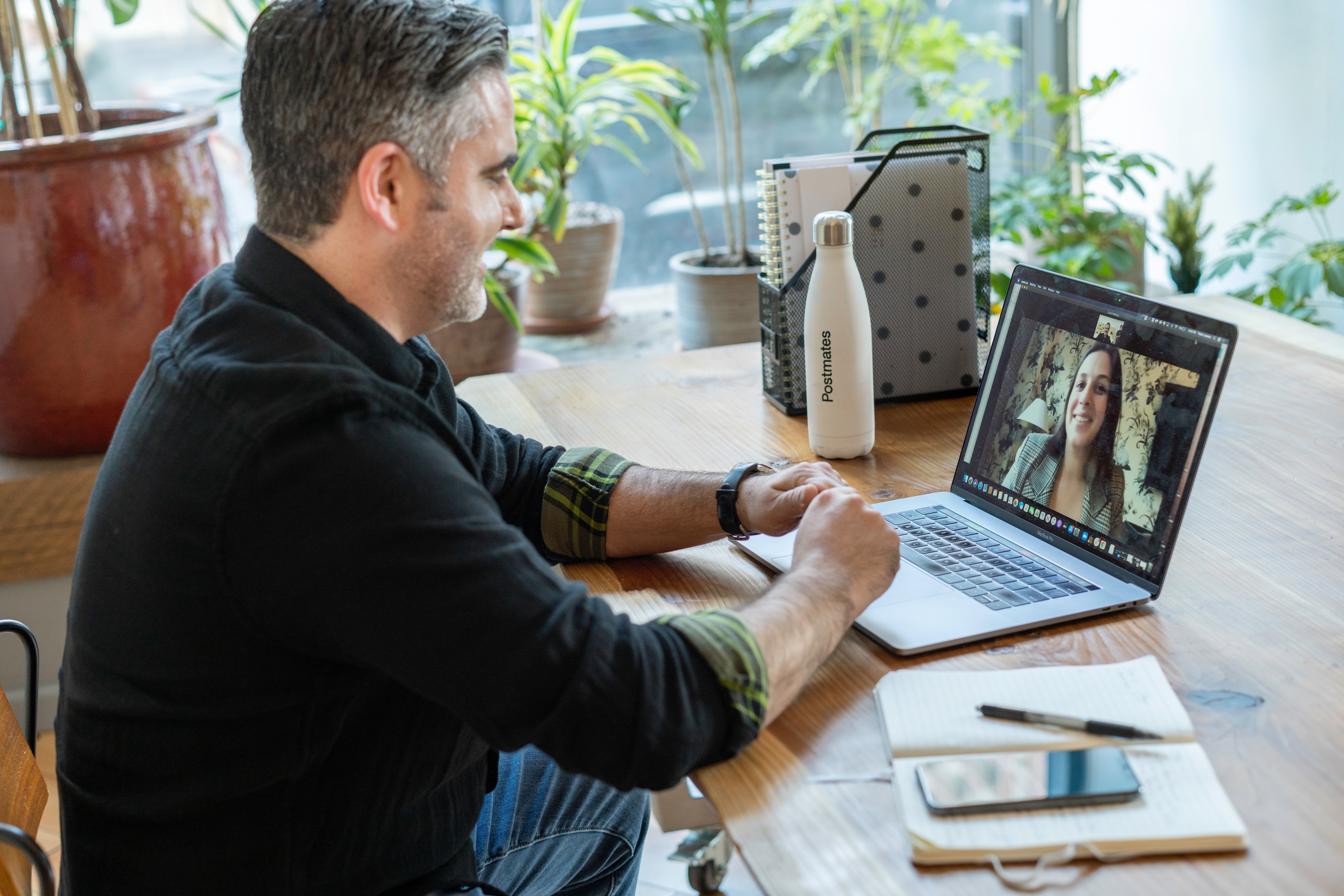 employee sitting in front of laptop video calling