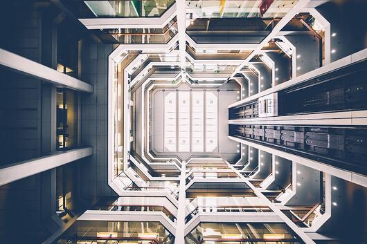Internal, upwards shot of a futuristic building design.