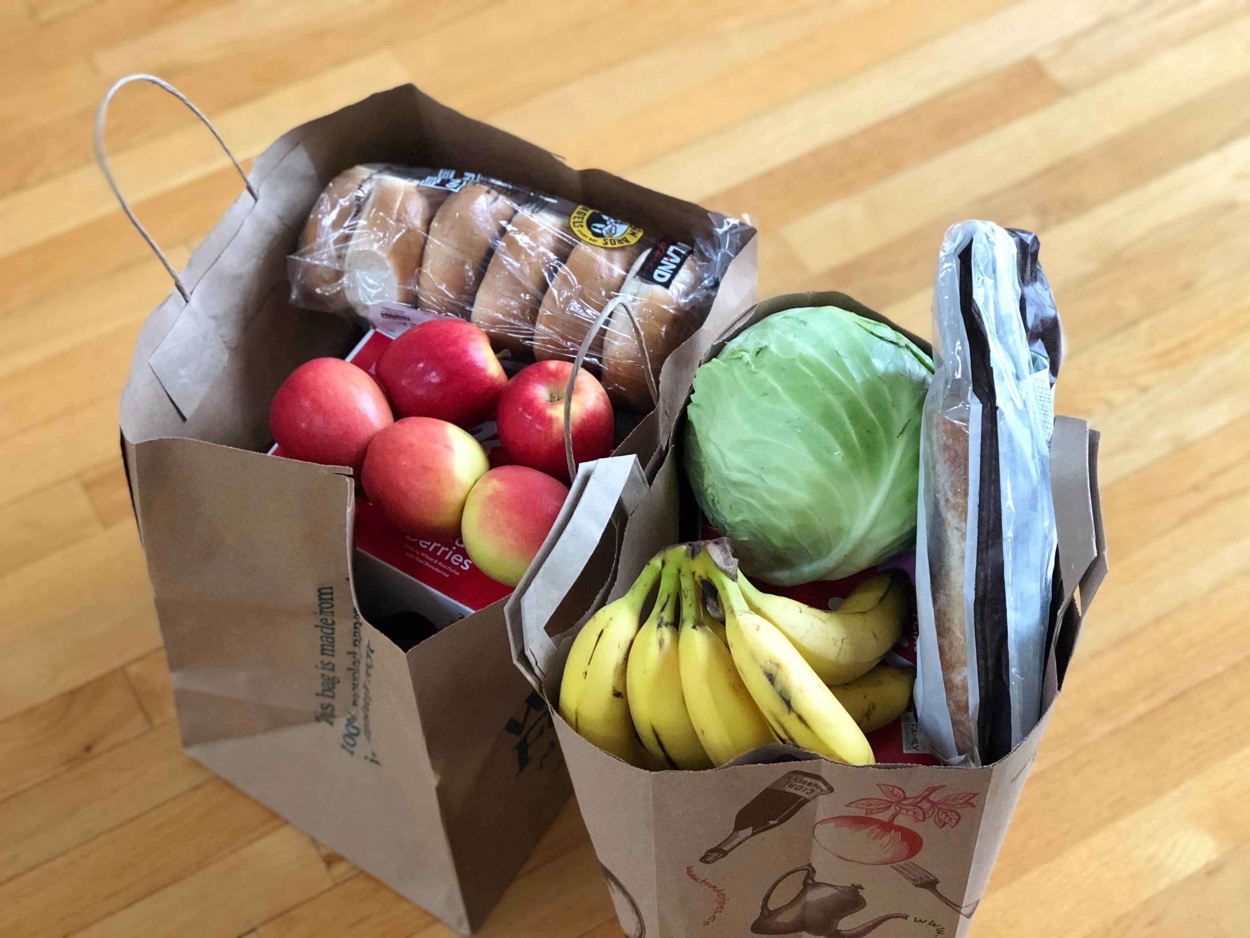 grocery order in brown paper bags