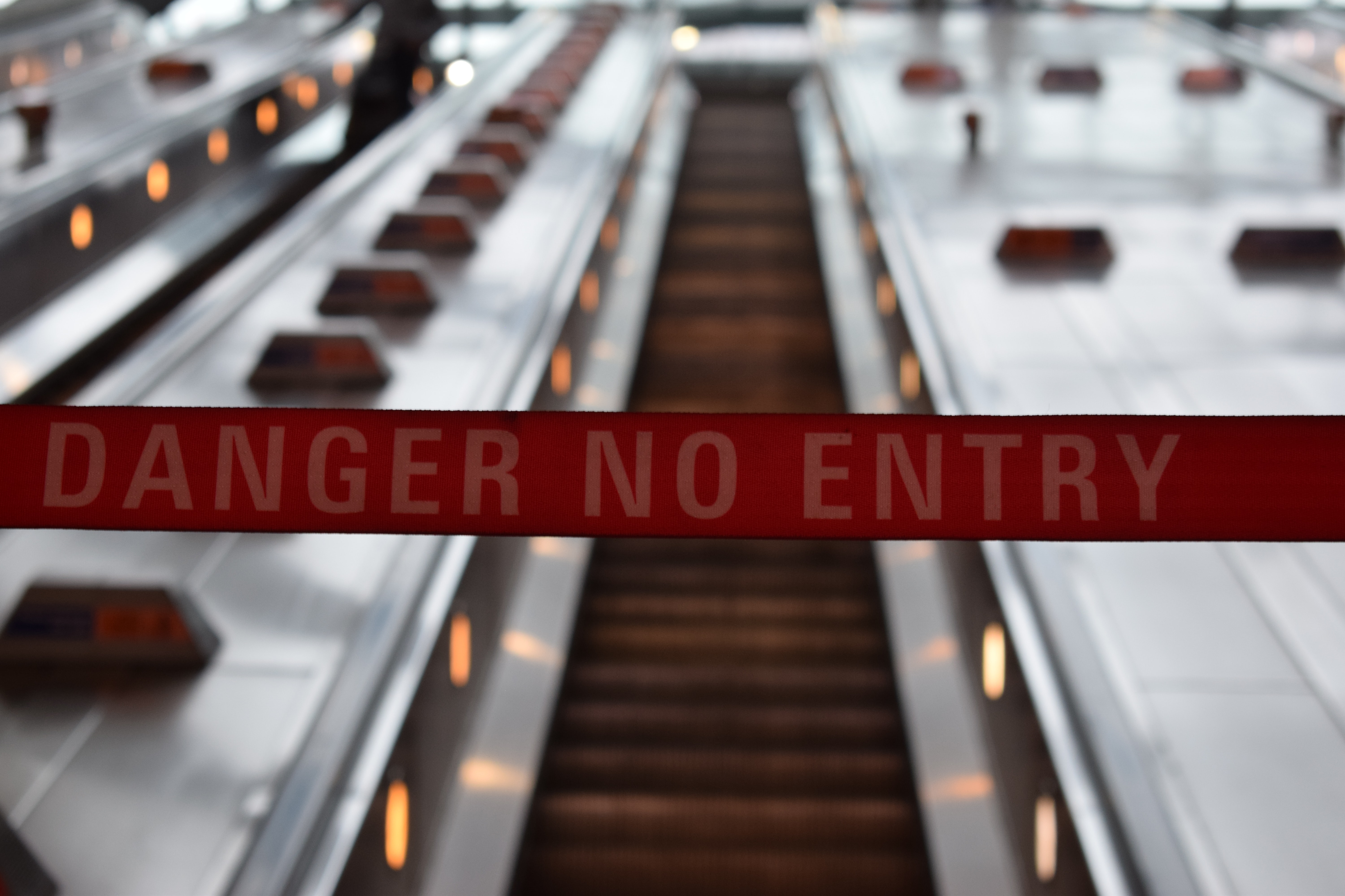 danger no entry sign in front of escalator