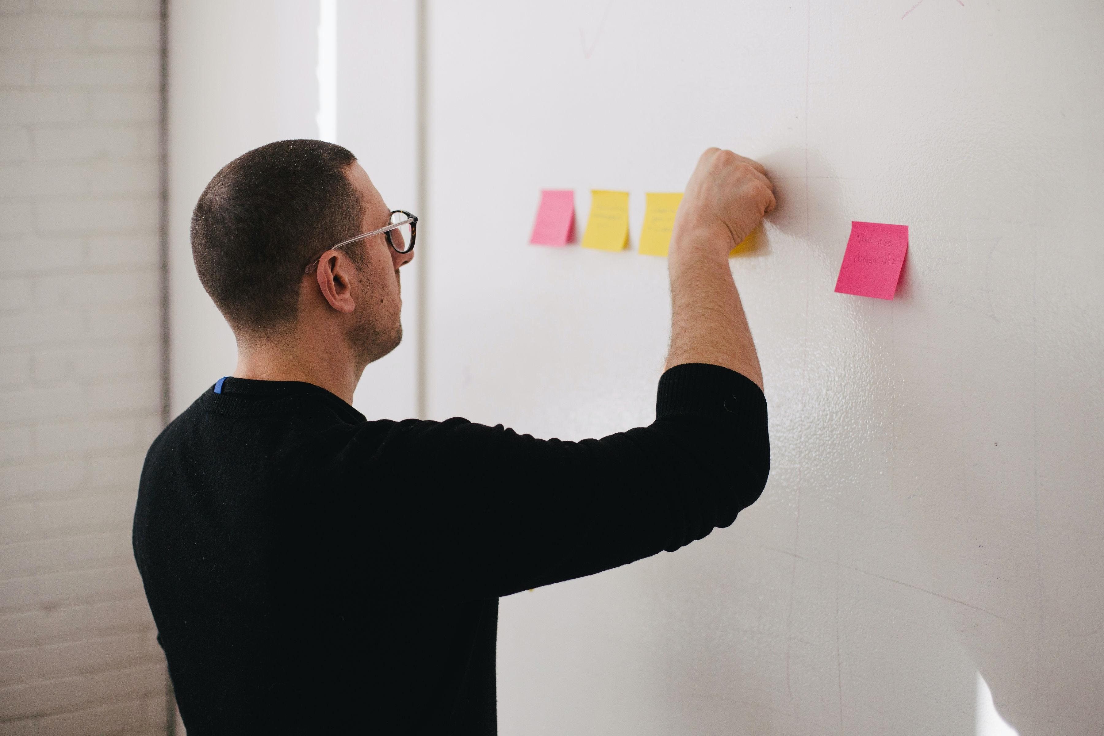 man-sticky-notes-whiteboard