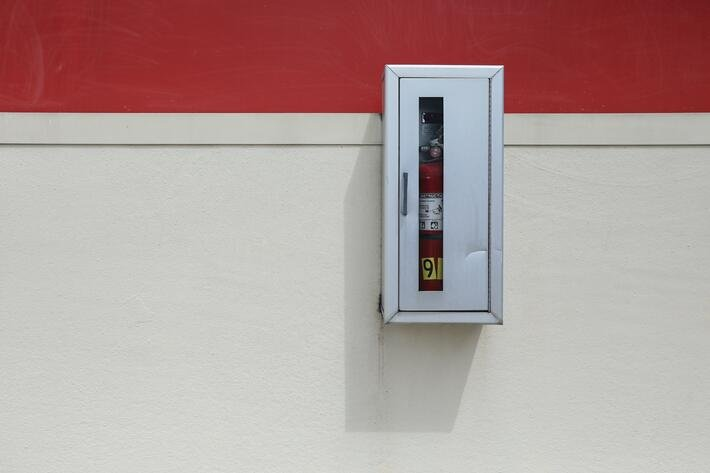 fire extinguisher mounted on wall