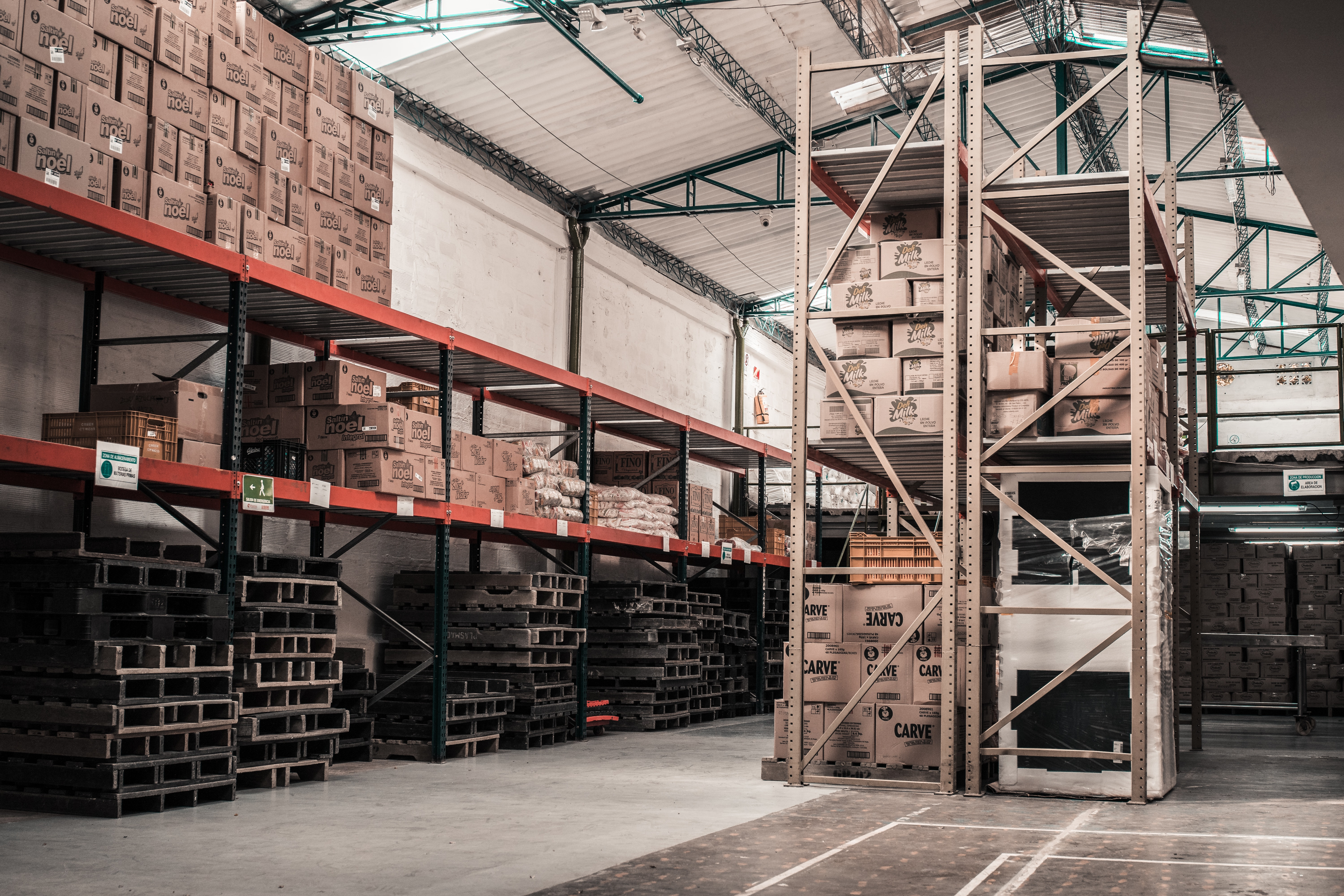 warehouse floor with pallets and boxes