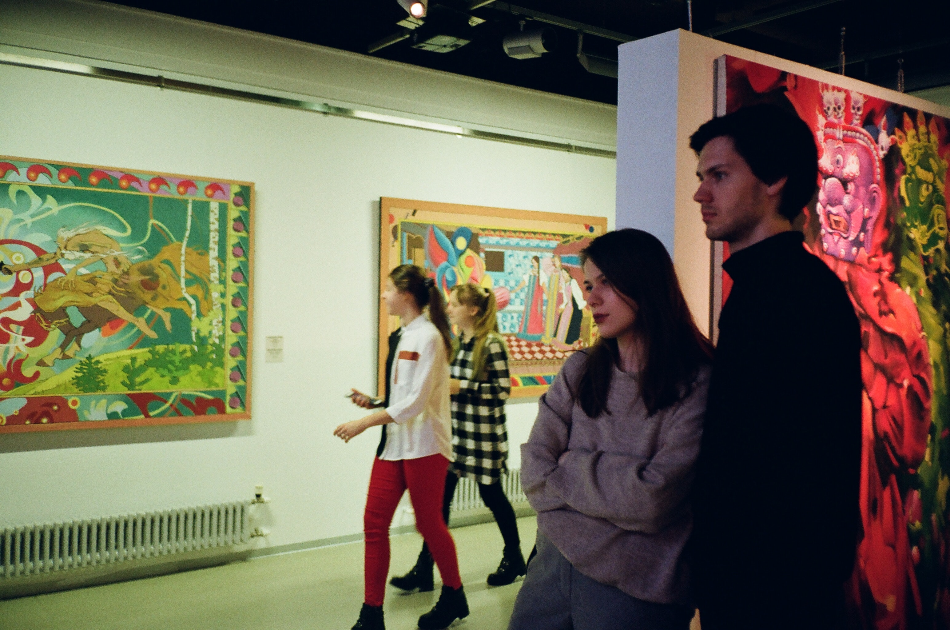 people navigating through a museum