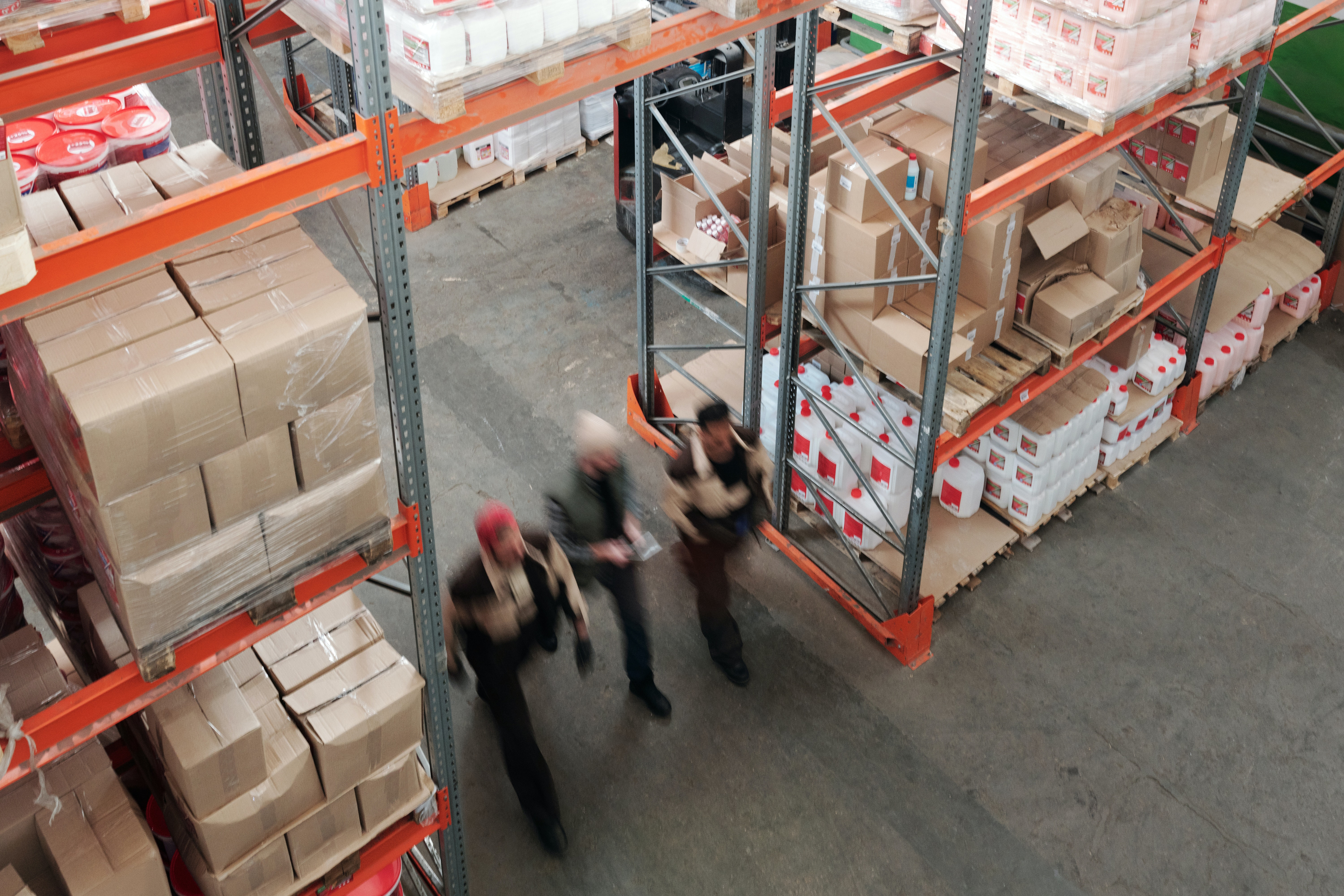 warehouse workers quickly travelling through the building